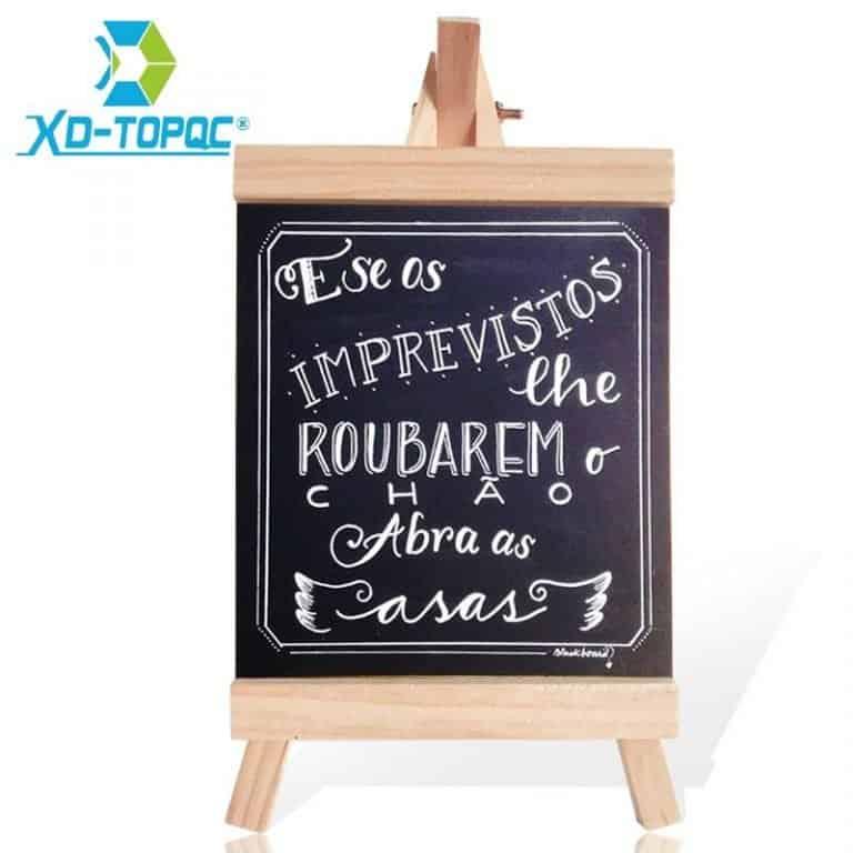 Wooden desktop blackboard for writing motivational phrases