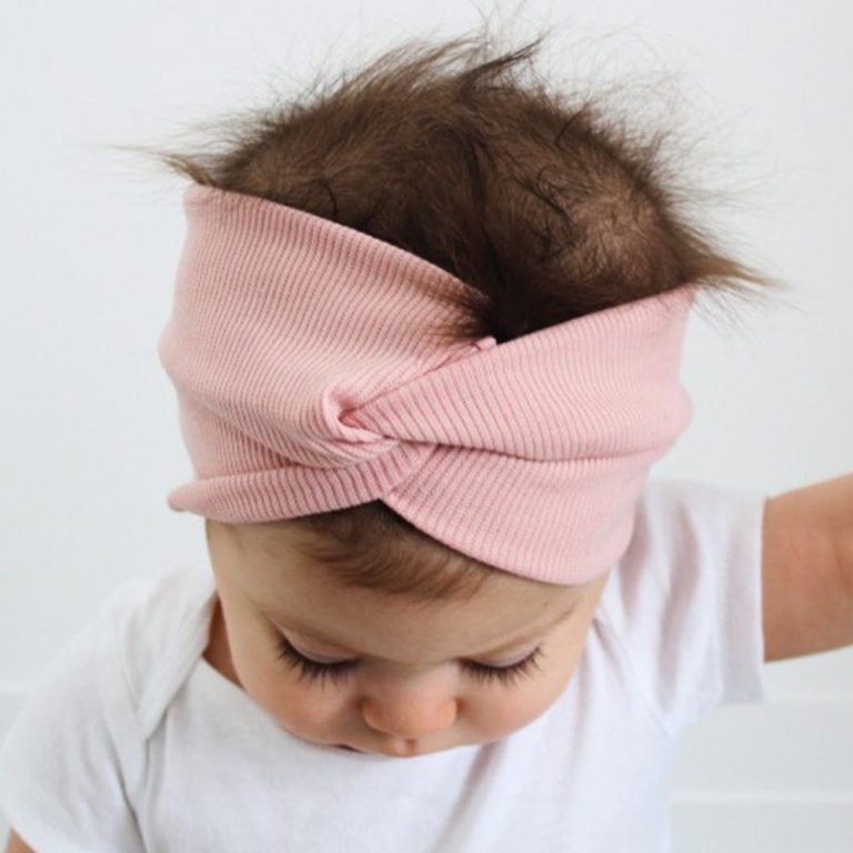 Screenshot of a baby wearing a pink knotted headband