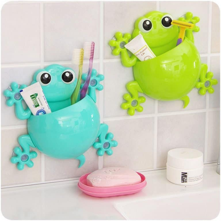 Bathroom wall with two frog-shaped bathroom accessory holders