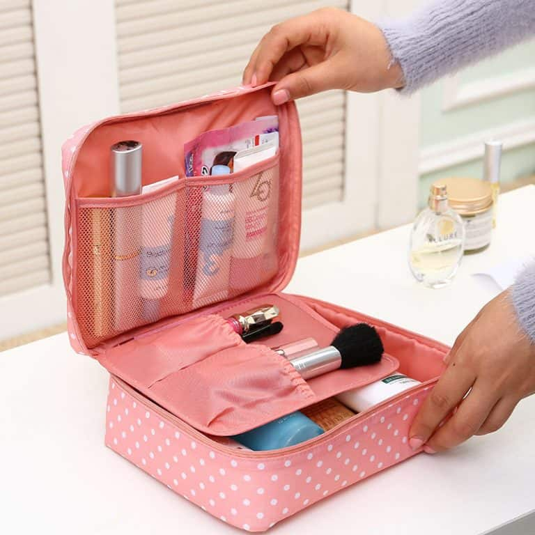 A woman opening a retro-style polka-dot organizer