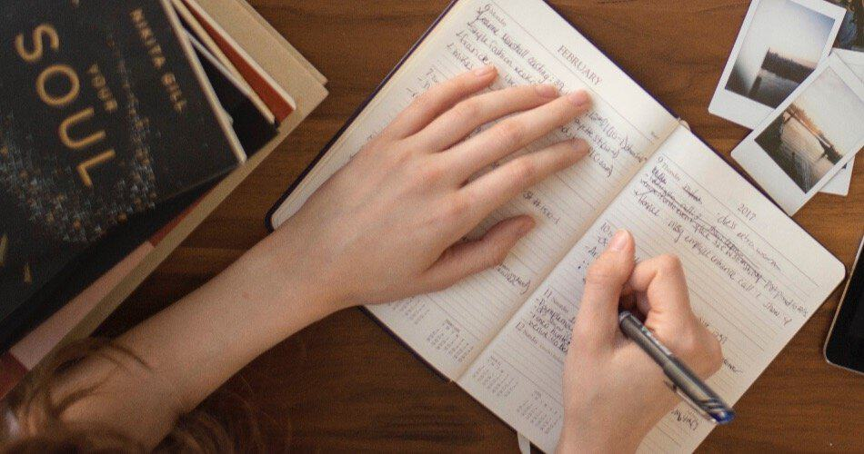 A woman making notes in a notebook