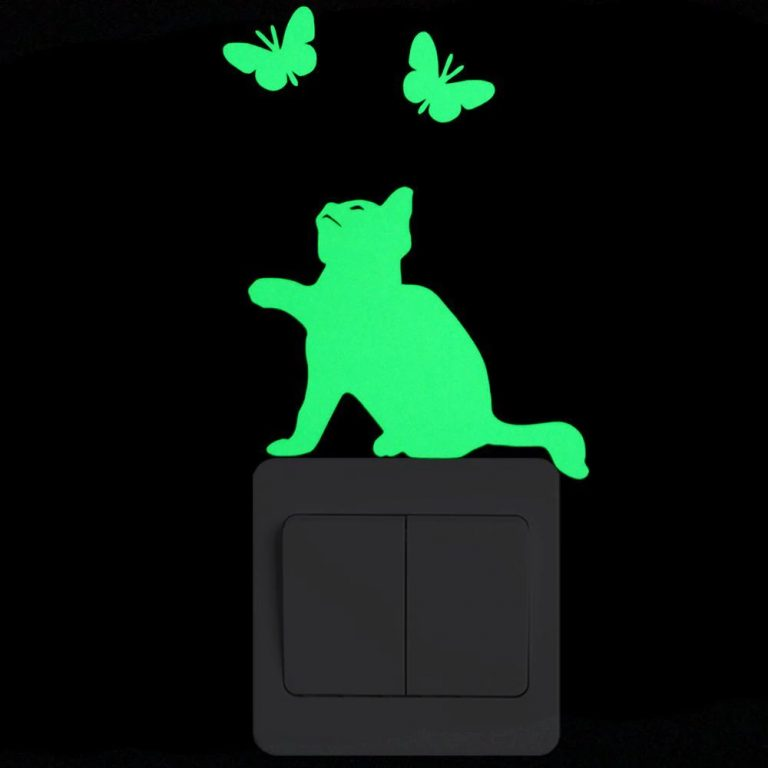Photo of a luminous wall sticker depicting a cat and butterflies